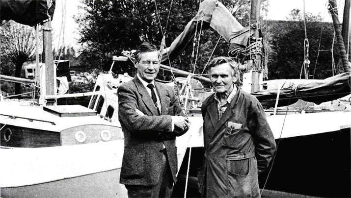 Wil (left) and Arnold Valentijn in front of two Groningen scows